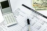 sestavu výkazu příjmů s peníze kalkulačka, pero a usd za b