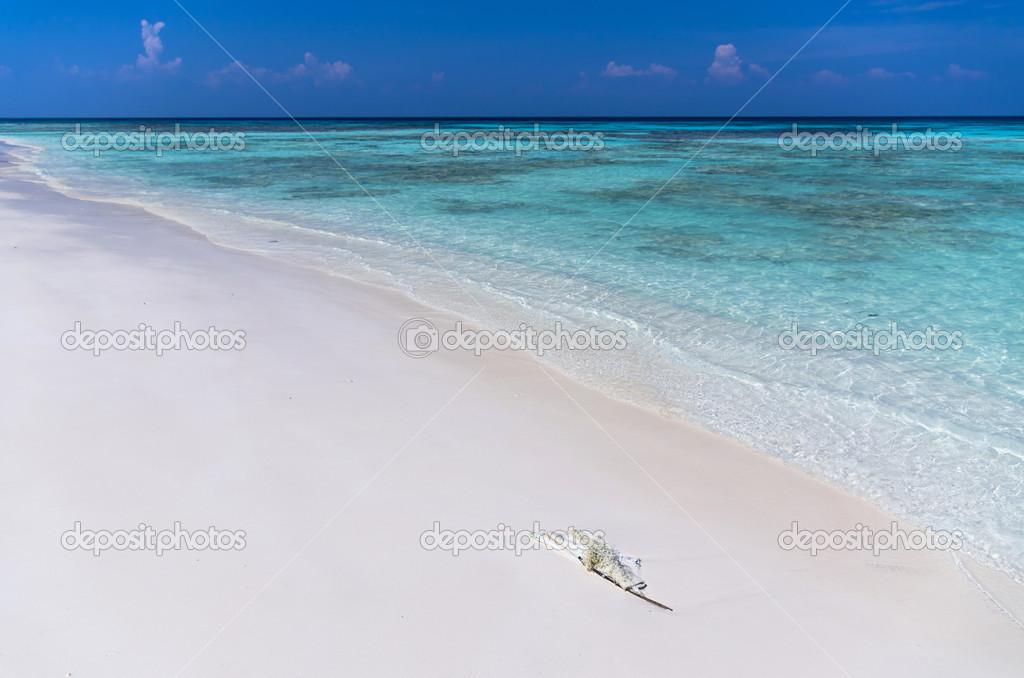 White sea beach with blue sea and sky, beautiful nature