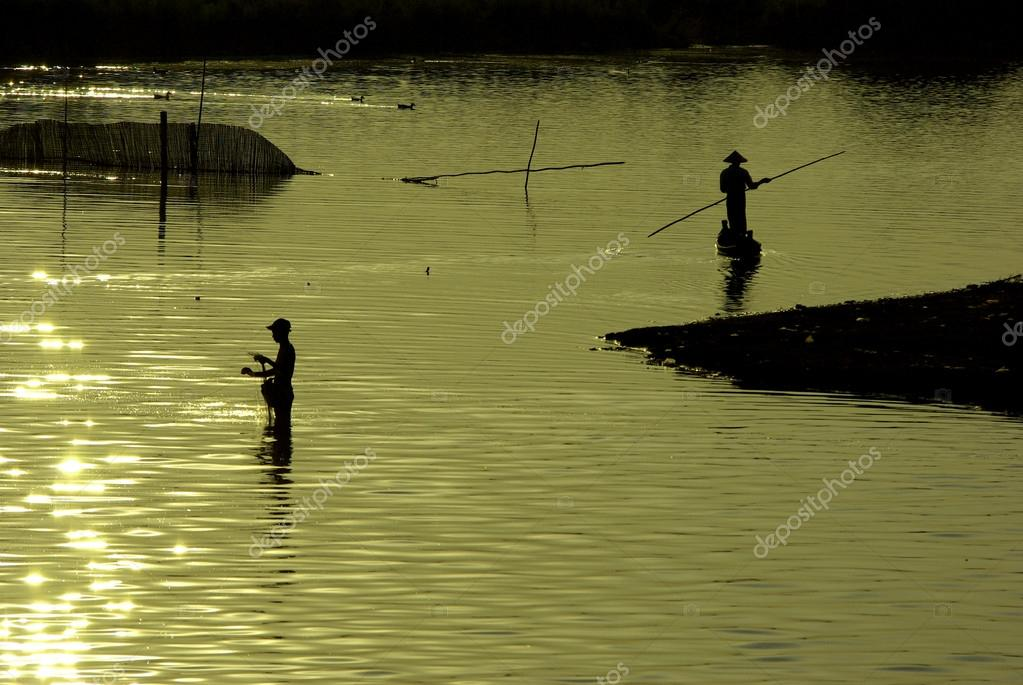 traditional fishing during sunset, U-Ben Bridge, Mandalay, Myanm