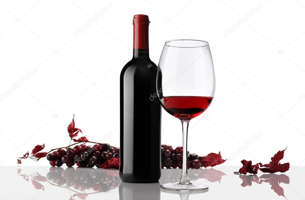 composition of wine bottle and glass with bunch of grapes on whi