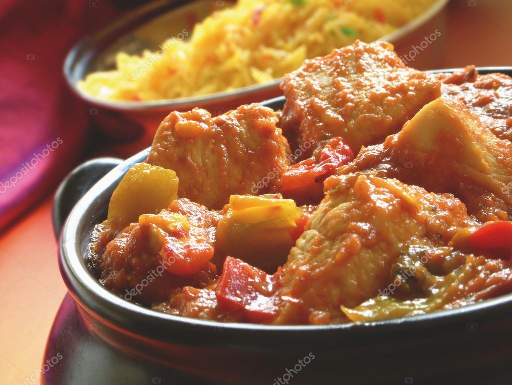Indian Rogan Josh curry in bowl with pilau rice