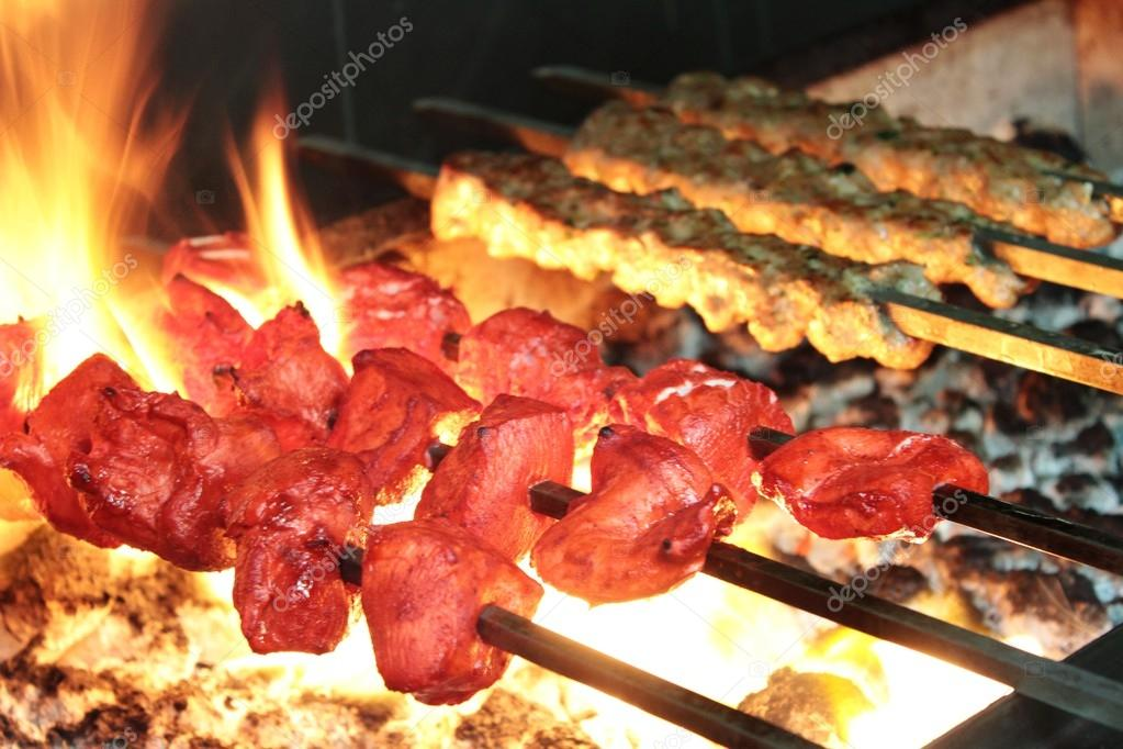 Indian chicken tikka and kofte kofta shish kebabs on barbecue