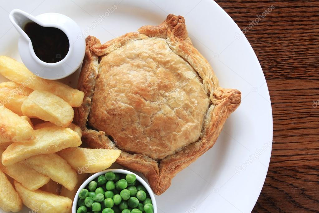 Steak pie with fries and peas plated meal — Stock Photo ...