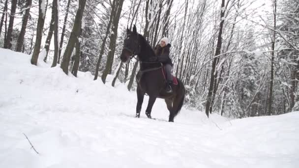Woman petting her horse while riding in winter