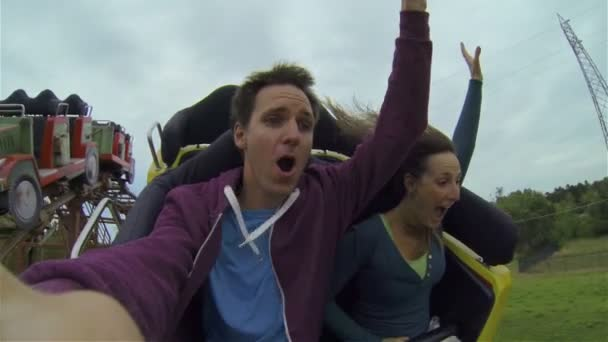 Young couple on rollercoaster