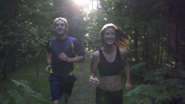 Couple jogging through the woods