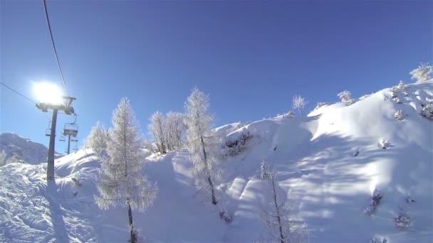 Ski lift ride on sunny day