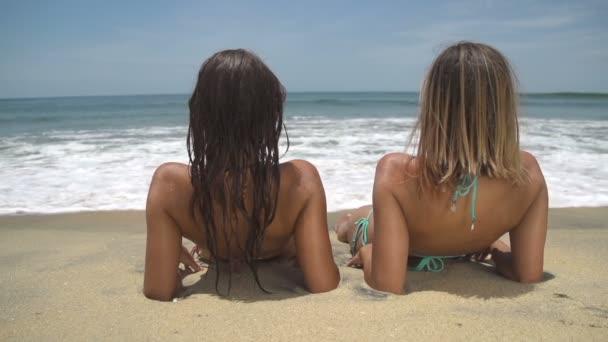Sisters lying on beach