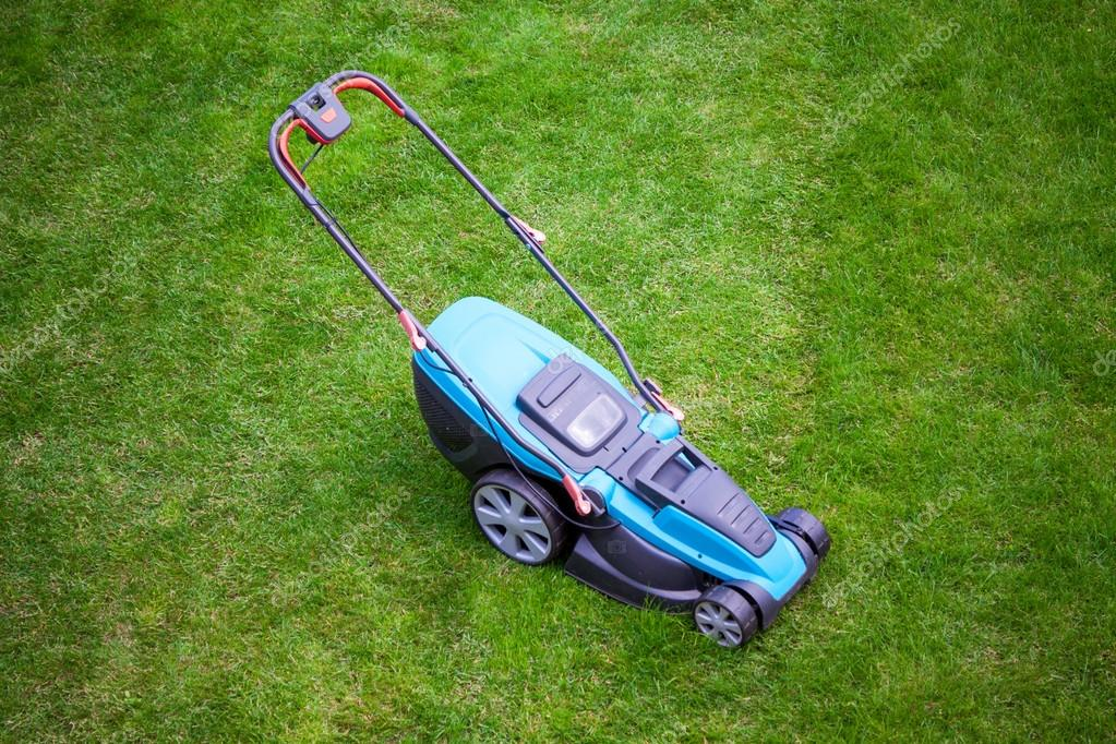 blue lawn mower on green grass