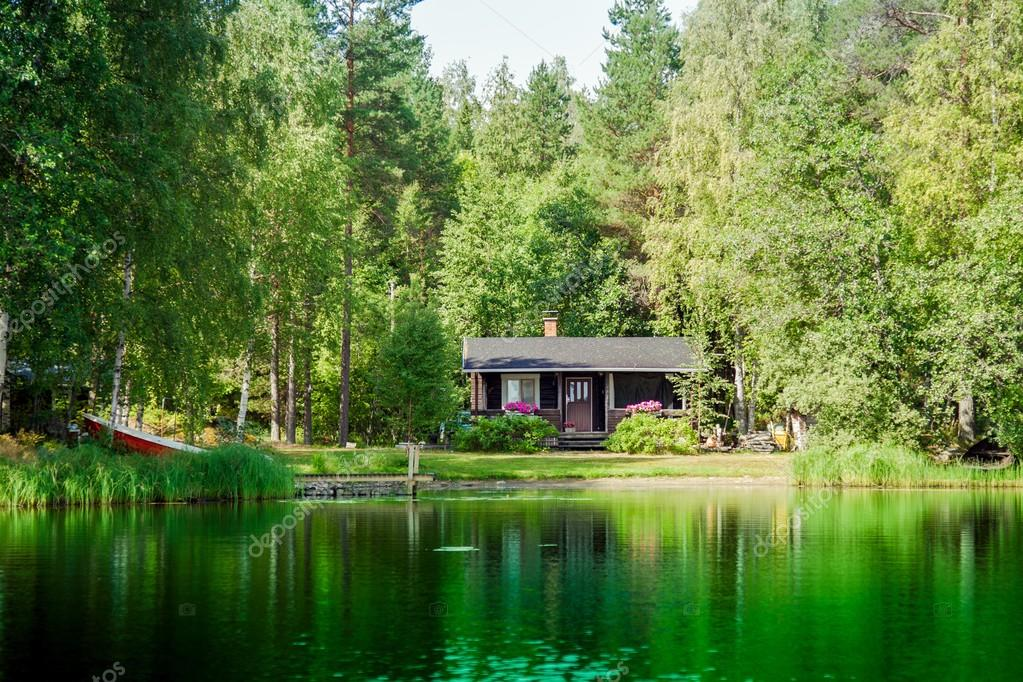 Old Finnish Summer Cottage At A Lake Stock Photo