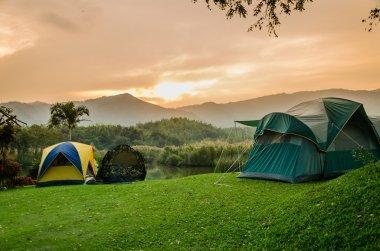 tent set on the grassland of mountain