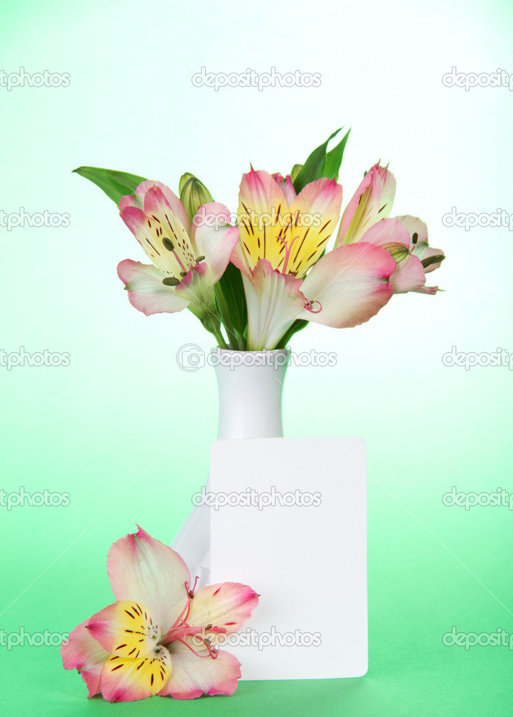 Pink Alstroemeria In A Vase And An Empty Card On The Green Stock