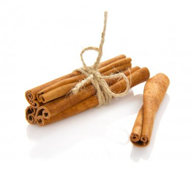 The fragrant sticks of cinnamon isolated on white