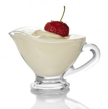Strawberry berry in a cup with cream isolated on the white