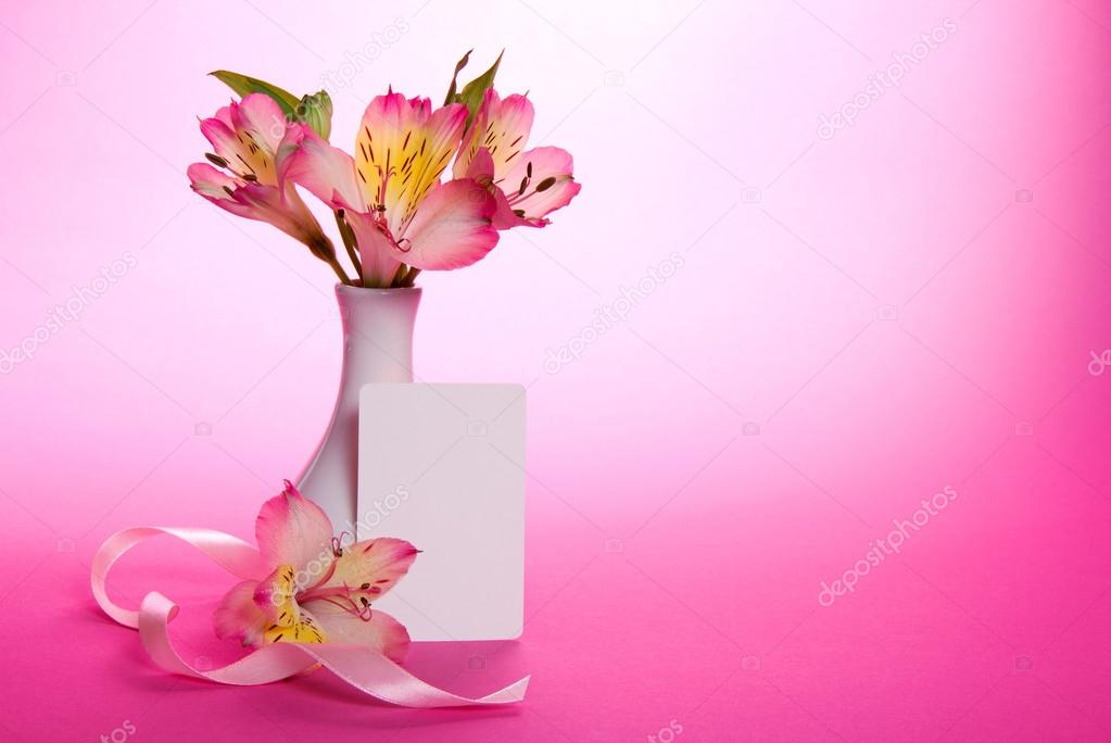 Pink Alstroemeria In A Vase And An Empty Card With A Ribbon On A