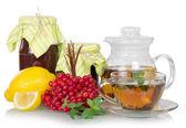 Fotografia tè, menta, limone, viburno-rosa, marmellata
