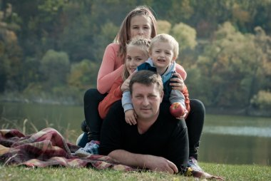 Happy large family with children in autumn park