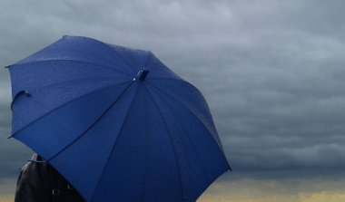 Blue wet umbrella for keeping you dry