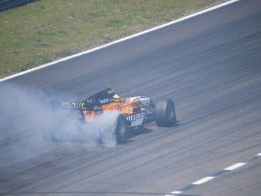Tom Coronel burns some rubber in a Formula car in Zandvoort