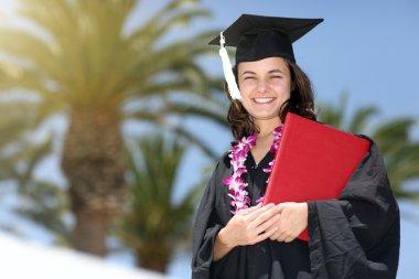 Happy graduate woman