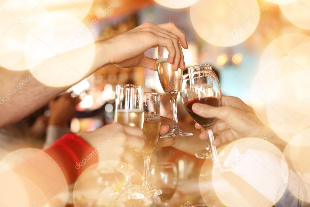 Hands holding the glasses of champagne