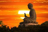 Fotografie Buddha při západu slunce