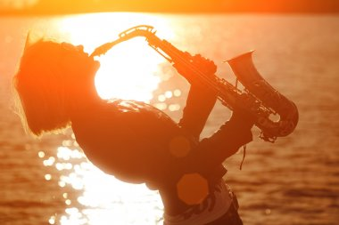 Woman playing sax