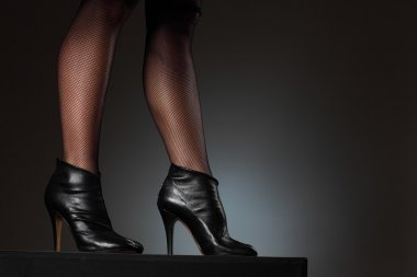 Female legs in high heel boots