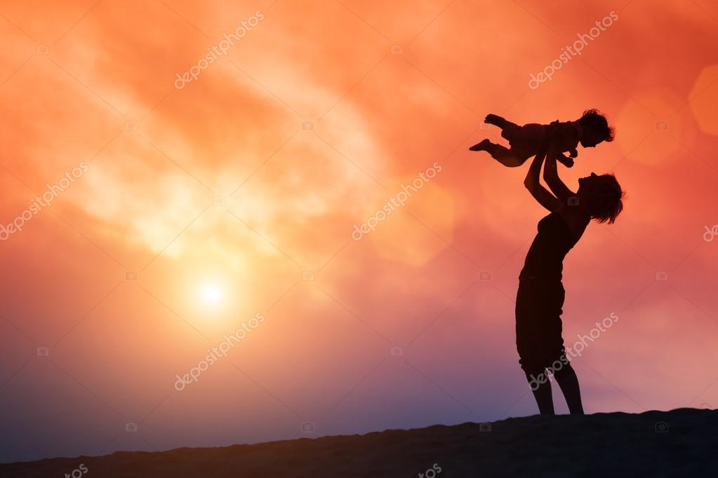 Mother lifting toddler child in air over scenic sunset sky stock vector