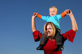 Boy riding on his mothers shoulders