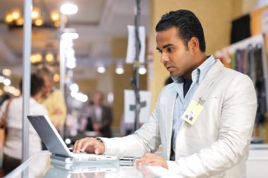 Young indian businessman using laptop