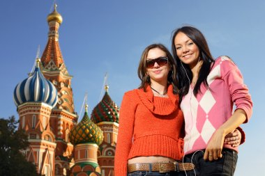 Young women next to Saint Basil's Cathedral