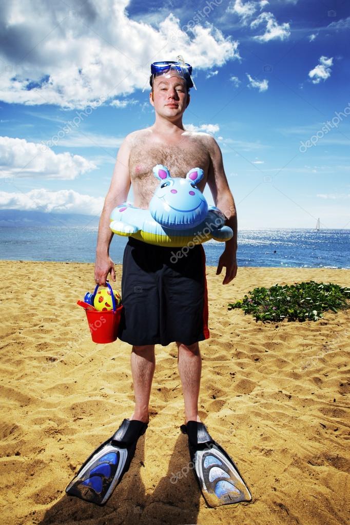 Man ready for fun at sunny tropical beach