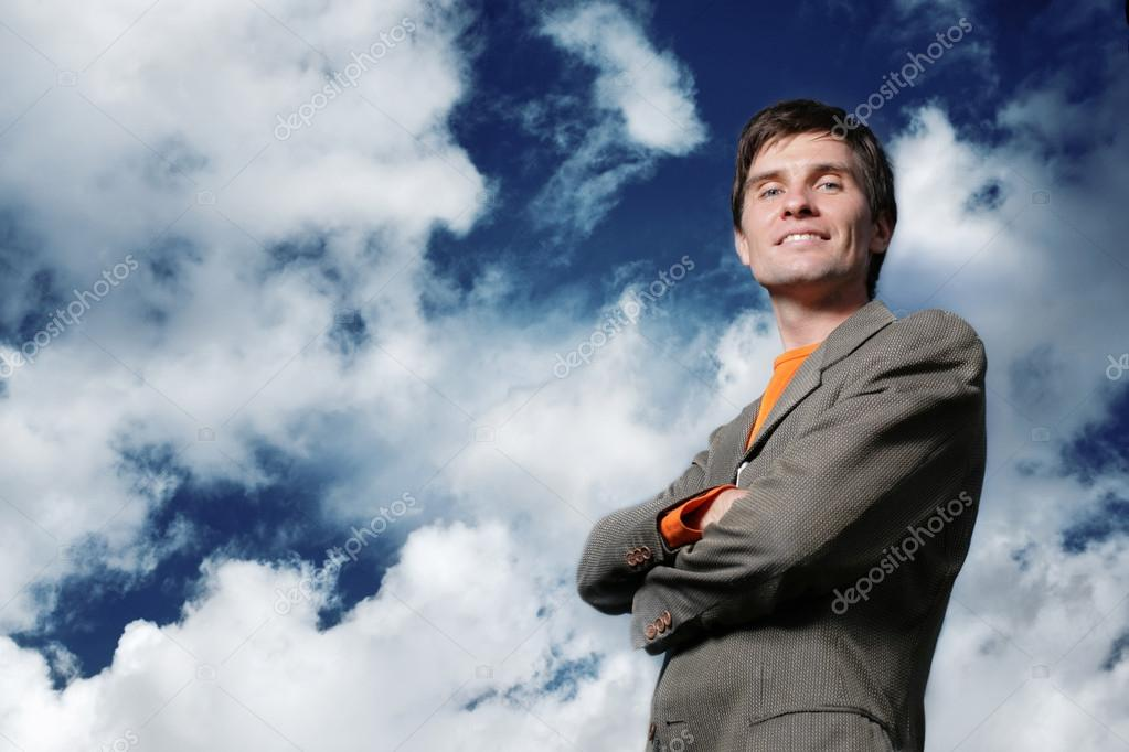 Businessman over blue sky