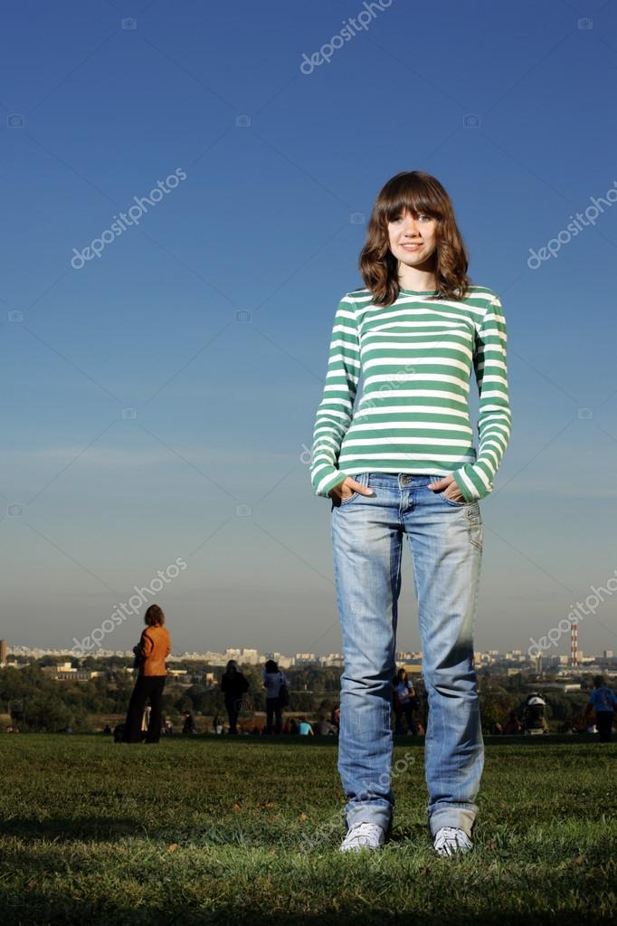 Confident teenage girl outdoors