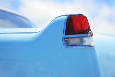 Rear light detail of a classic American car from 1950s