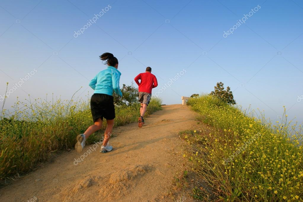 Two people running at Runyon Canyon Park