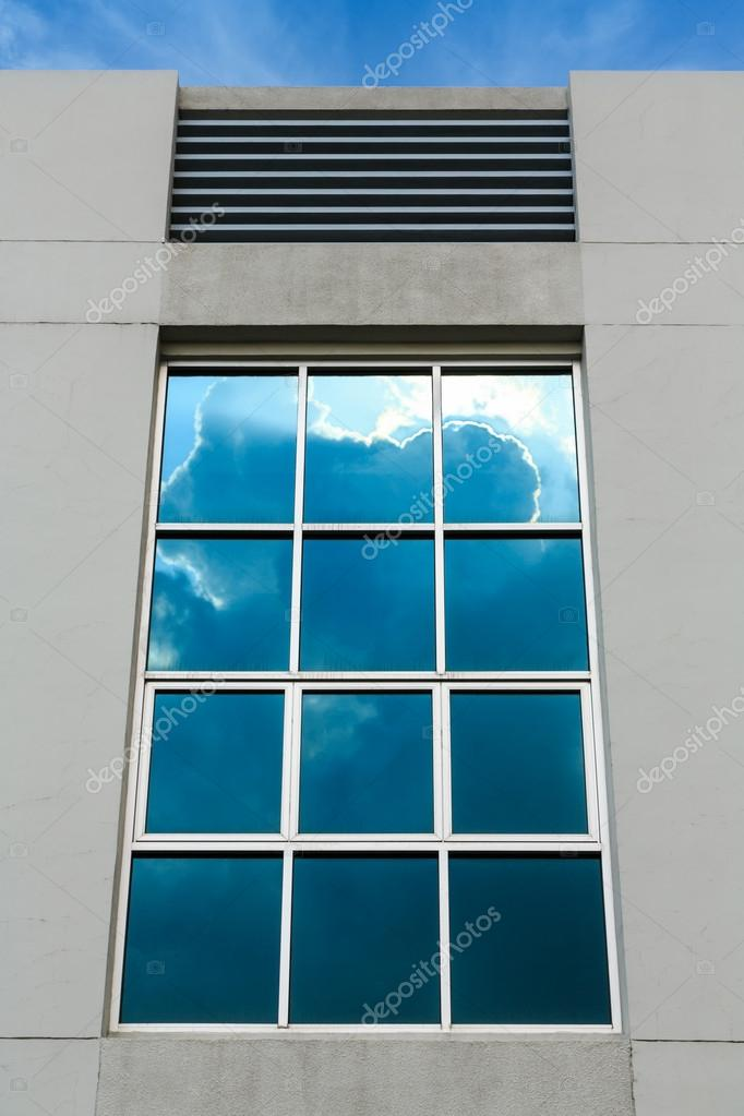 Clouds reflection on office window  building