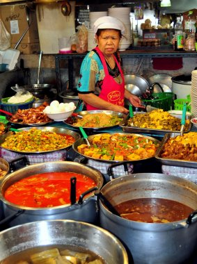 Bangkok, Thailand: Thai Woman Selling Food at the Or Tor Kor Market