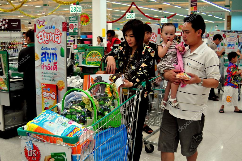 Chiang Mai, Thailand: Family with Shopping Cart at Tesco-Lotus Super Market