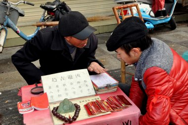 Pengzhou, China: Fortune Teller with Client