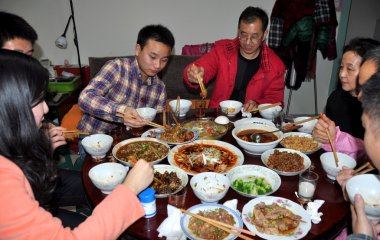 Pengzhou, China: Family Eating Tradtional Chinese New Year's Eve Dinner