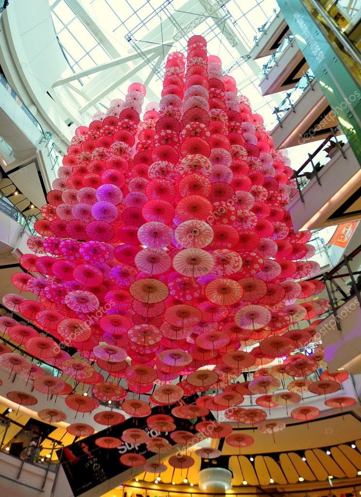 Bangkok Thailand An Enormous Mobile Of Pink Paper Umbrellas For The Chinese Lunar New Year Holiday Hangs In The Atrium Of The Central World Shopping Mall