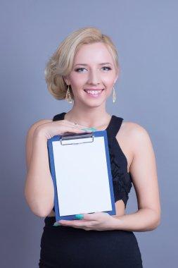 Fashion blond woman holding empty billboard