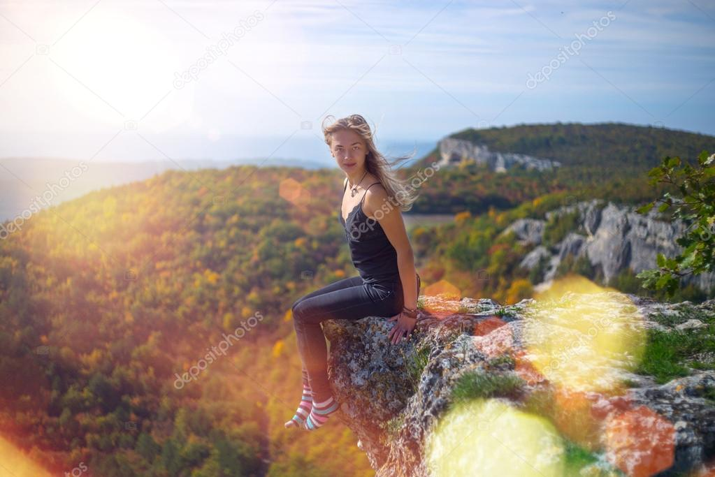The girl on the edge of the cliff