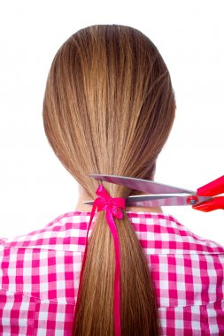 Woman with long hair and scissors cutting