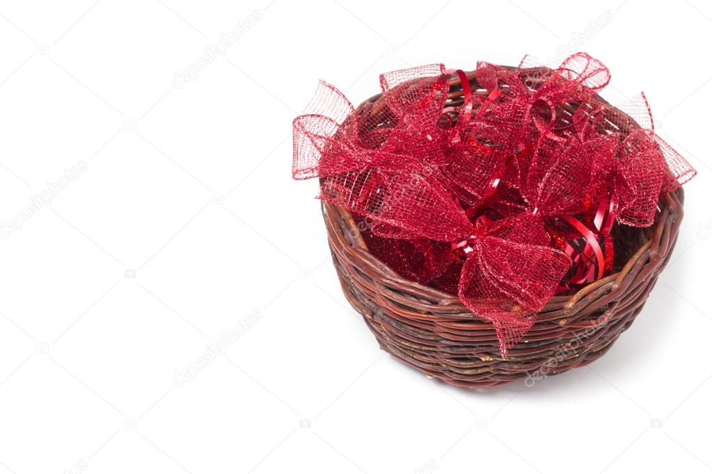 red christmas bows in wicker basket stock photo - Red Christmas Bows
