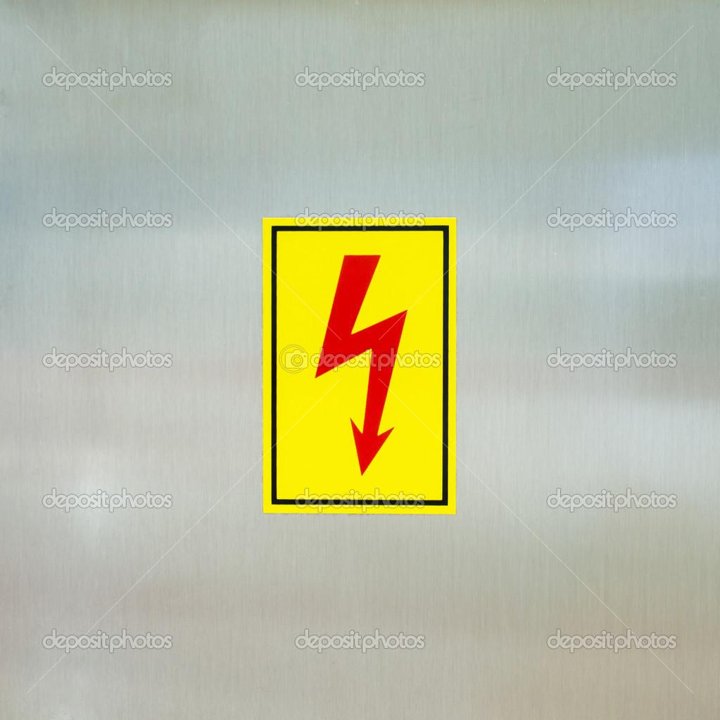 Danger high voltage symbol — Stock Photo © ctvvelve #39830359