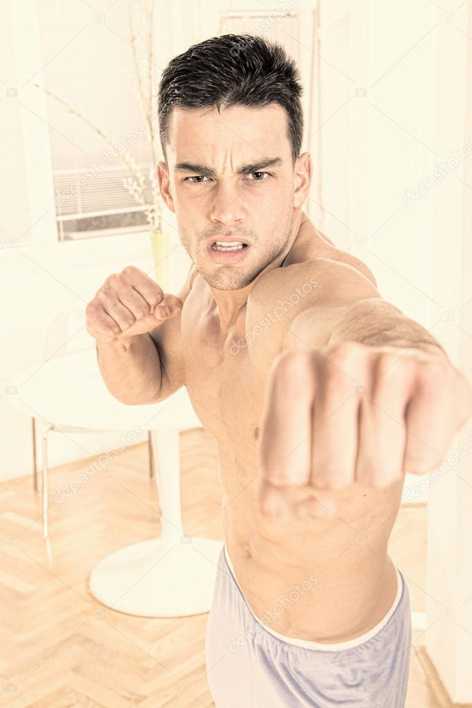 strong angry handsome man fighter punching towards camera — Stock ...