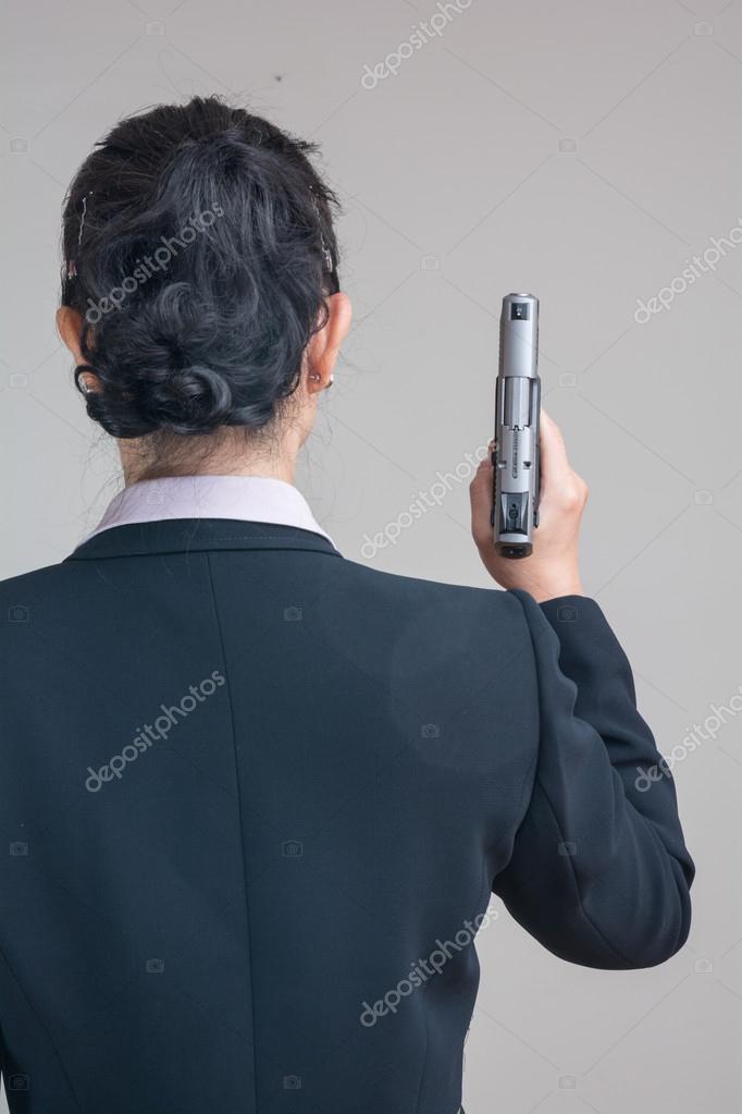 Woman holding a hand gun